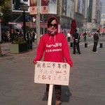 woman-iphone-5-protest-beijing-excerpt
